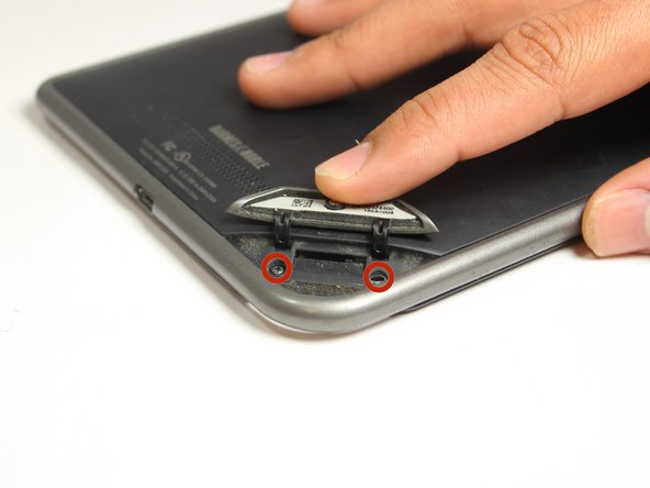 Use the T5 Torx screwdriver to remove the two 3.8 mm screws located in the back right corner of the device.