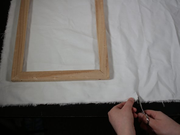 Measure out the amount of canvas that is needed to cover the edges of the frame.