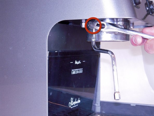 Using a wrench, unscrew the hex nut and remove the steam wand.