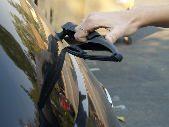 Using your thumb, push the wiper away from you and out of place. You will hear it click when it is coming off.