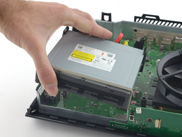 Remove the optical drive assembly from the Xbox.