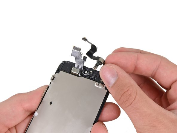 Remove the front-facing camera and rear microphone assembly.