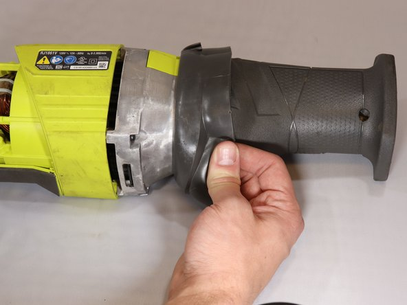 Begin to remove  rubber sleeve. You may have to use some force as it has a tight fit.