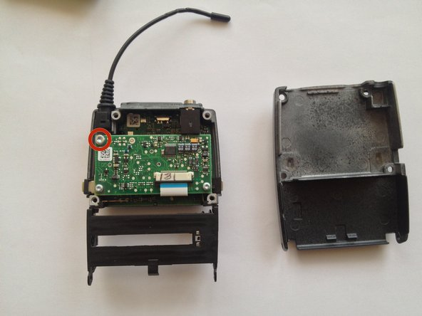 Remove the back cover and remove one more torx screw on the upper left corner.
