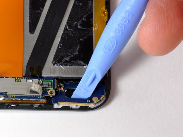 The antenna loop board needs to be pried up (it is glued down). Gently use a plastic opening tool or spudger, to dislodge the antenna loop board. The board is connected to the antenna electronics by a small ribbon cable. This two-board assembly is very frail.