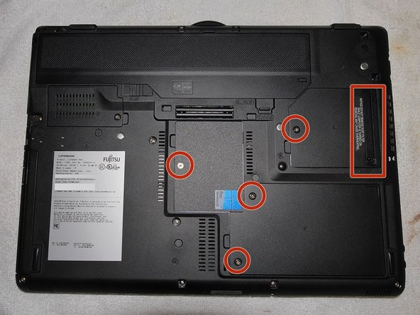 With battery removed take out the fan dust catcher (indicated by the red rectangle).
