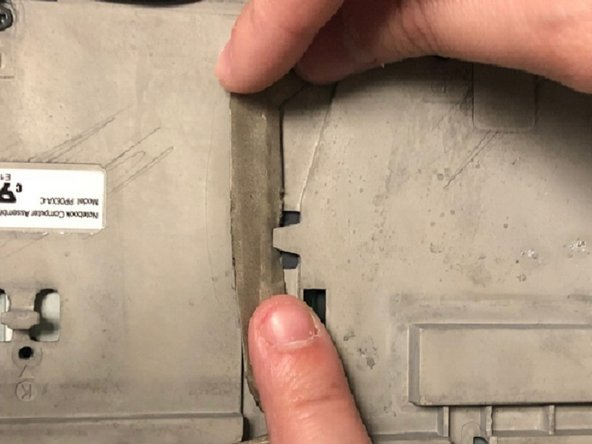 Disconnect the display connectors by removing them from the grooves and unplugging them.