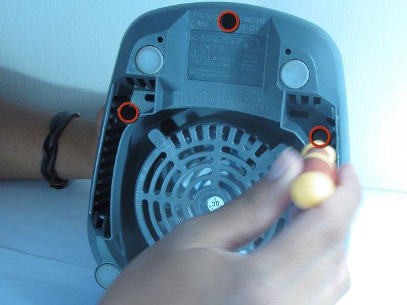 Remove the top three 1/4 inch base screws using a Philip's head screwdriver.