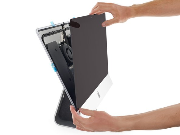 Gently set the display in place over the iMac and align it carefully.