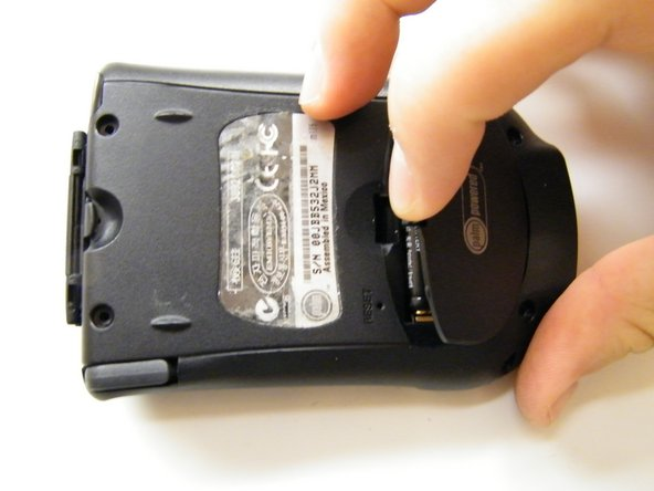 Press the latch on the battery door on the back of the device and pull outwards.