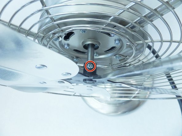 Remove the 8 mm bolt fastening the fan blades to the rotor with a Phillip #3 screwdriver.
