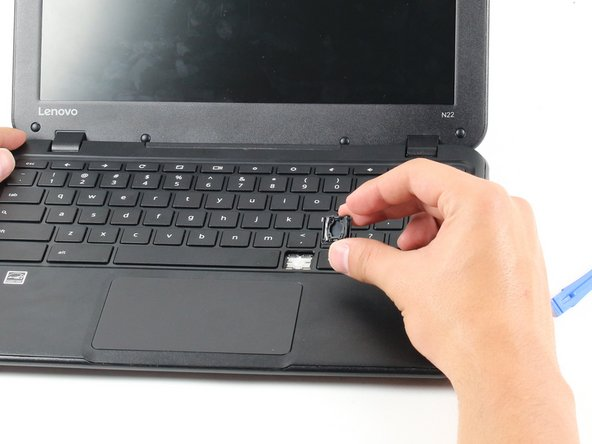Remove the key from the keyboard by prying the key off with the opener or with your finger.