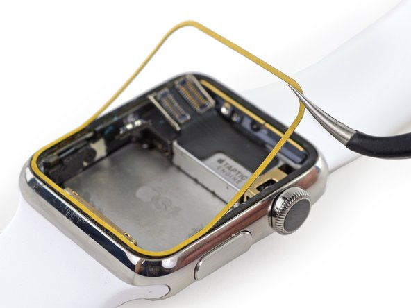 Lay the backed adhesive tape down on the Force Touch sensor, around the edge of the case where the screen rests.