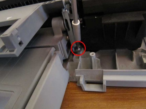 Remove a screw, just to the right of the paper tray.