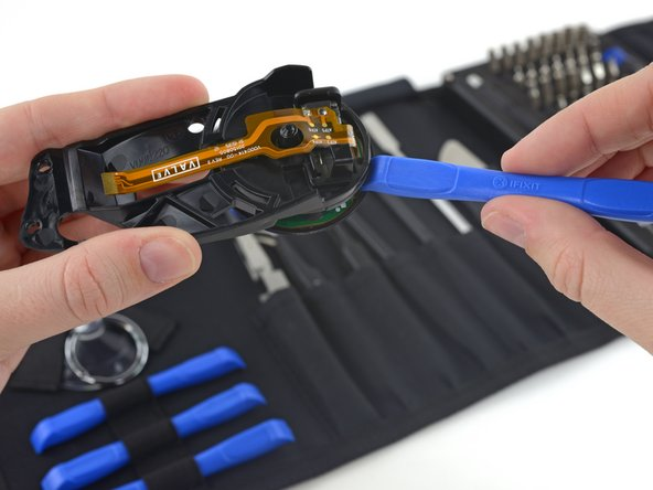 We finally break out our favorite tools to bust the touchpad out from behind its bracket bars. This time, we're using a plastic opening tool from our all-new Pro Tech Toolkit.