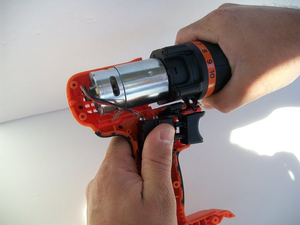 Gently remove the chuck and motor assembly from the drill case.