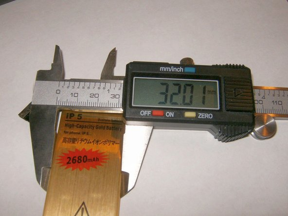 Width of the Gold Battery is 32.01 mm vs. 31.5 mm for the standard battery