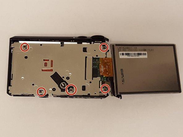 Using a JIS J000 screwdriver, remove the five 30mm JIS screws identified in the metal frame.