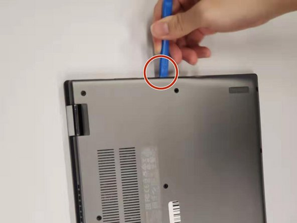Use an opening tool to pry the back cover open.