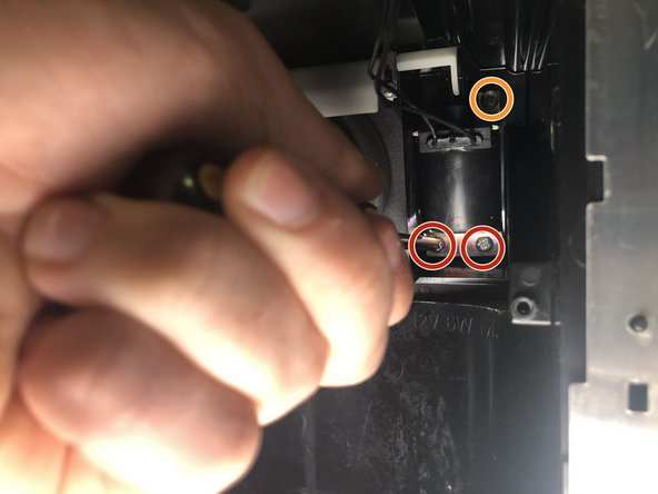 Remove the bottom two 2.5mm Phillips screws first.