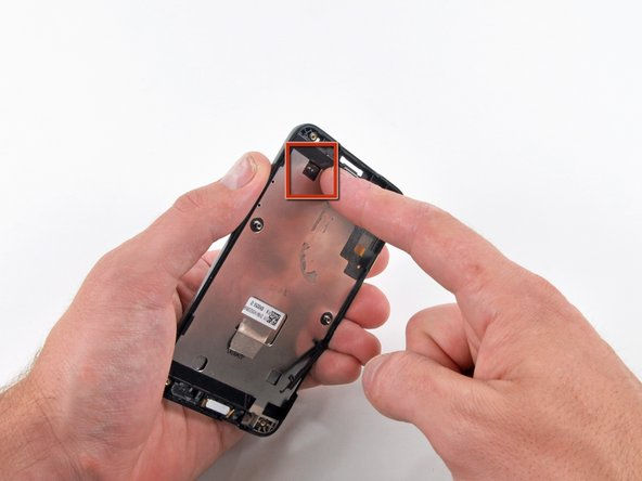 To gain enough clearance to insert an iPod opening tool, it is necessary to simultaneously push the LCD panel outwards while prying along the edges. It is recommended to push through the opening located near the bottom left corner of the Evo.