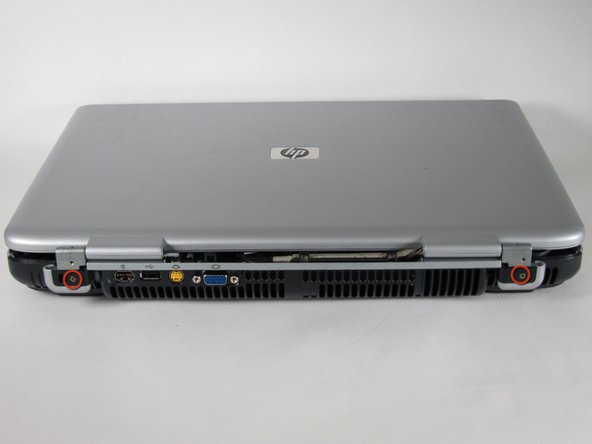 Close the lid and rotate the laptop so that the vents are facing you.