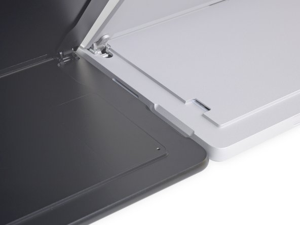 With the kickstands raised, we can see that the Pro X gets a sleeker hinge—likely shaving off precious thickness.