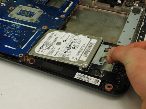 Gently slide the hard drive away from the motherboard to disconnect it.