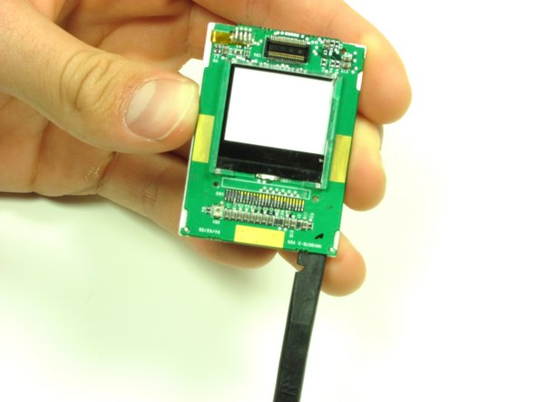 Flip the screen over so that you can see the outer LCD screen and the circuit board.