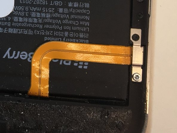 One T5 (lower) and one PH00  (upper) screwdriver heads are needed to remove the battery's connector shield.
