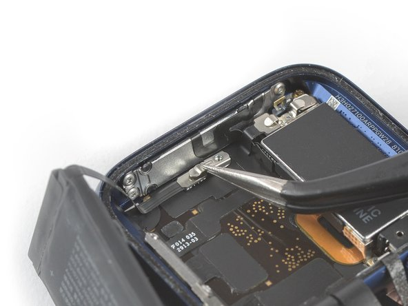 Use a pair of tweezers to remove the metal shield covering the battery connector.
