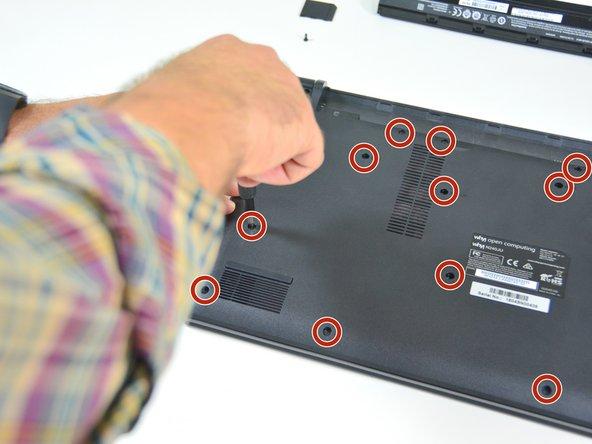 Repérez les 15 vis qui maintiennent le capot inférieur de la machine.