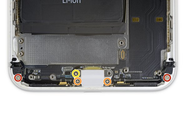 Remove the five Phillips screws securing the Lightning connector assembly to the rear case: