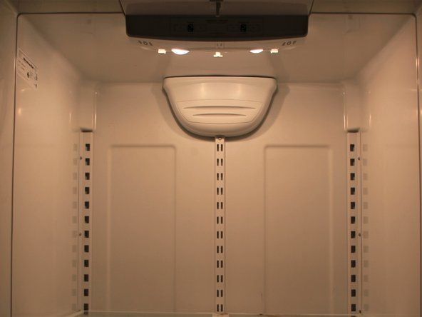 After screwing the new light bulbs in their housing, plug the fridge back in to test whether the lights work.