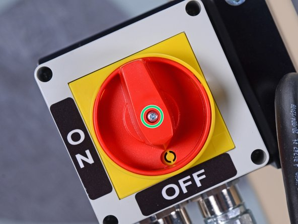 Use a Phillips screwdriver to remove the screw from the center of the red on/off knob.