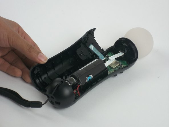 Once the device is opened, lift the battery out of the black plastic holder.