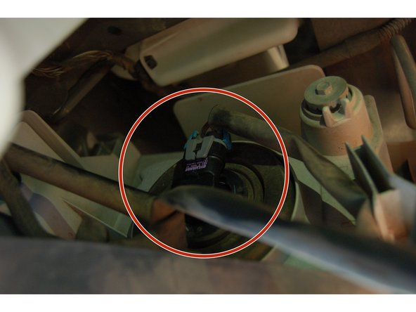Locate the bulb. It will be in the front and to the side. Start with the side opposite from the battery.