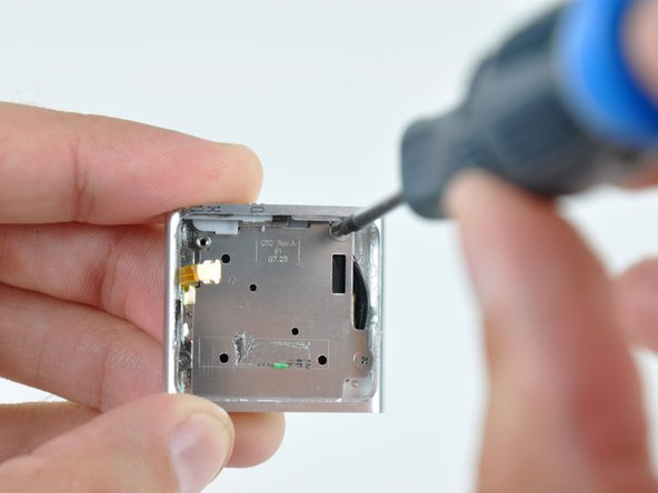 Removing the last four screws in the iPod Shuffle, which secure the control pad to the front of the iPod.