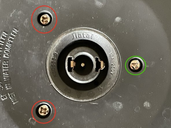Remove the two Phillips screws (circled in red on the picture) and use a triangular bit to remove the third screw (circled in green on the picture)