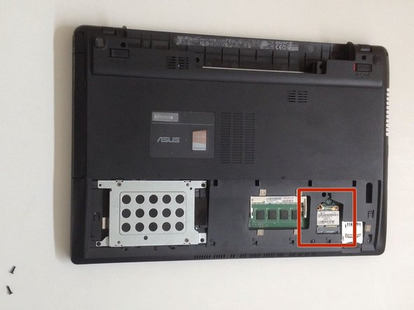 The Wireless card is held by one small Philips screw. Remove it.