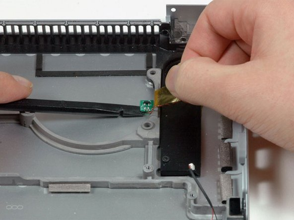 Peel up the orange Kapton tape covering the right thermal sensor.