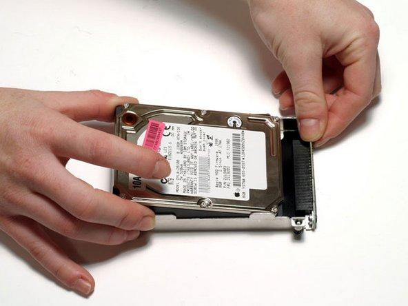 Turn the hard drive bracket over.