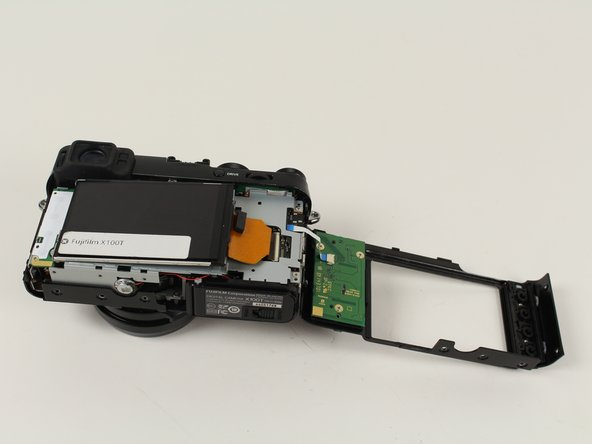 Remove the orange ribbon cable by opening up the ZIF connector with a plastic prying tool or toothpick.