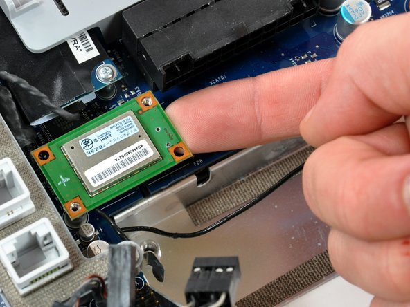 Use your finger to lift the Bluetooth board from the right edge up off its socket on the logic board.