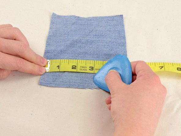 Grab a scrap of denim or other heavy-weight fabric and mark your measurements plus one inch in each direction.