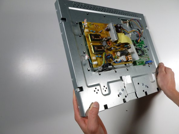Turn the monitor on its side so that the power supply and circuit board are facing to the right