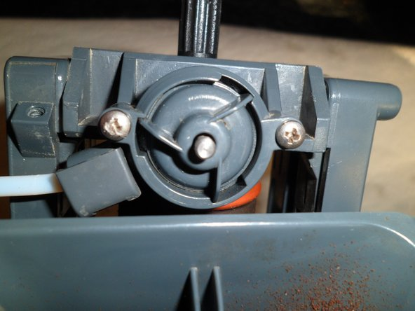 Remove the two screws holding the valve in place and remove it.