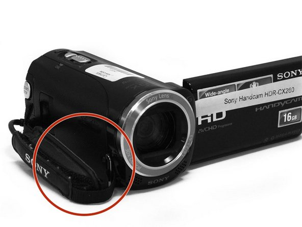 Remove one 5 mm screw by the lens and two 5 mm screws under the handle.