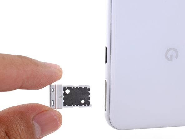 Remove the SIM tray from the phone.