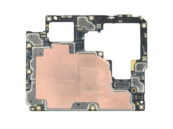 And on the even darker rear side, a huge expanse of copper conceals these tiny bits of silicon: